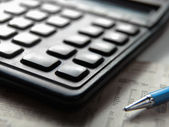 Office still-life, calculator and document — Stock Photo