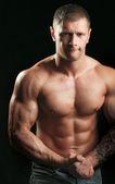 Muscular young man — ストック写真