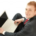 坐在地板上轻松成熟的业务人 — 图库照片
