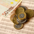 Money: euro coins and bills close up — Stock Photo #32652161