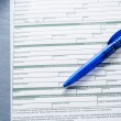 A blue pen on a rx prescription — Stock Photo #32652407