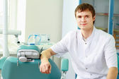 Man dentist at his office smiling — Stock Photo