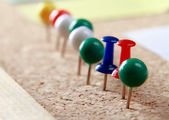 Close up of three push pins — Stock Photo