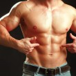 Muscular young man showing abs. — Stock Photo #33836533