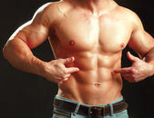 Muscular young man showing abs. — Stock Photo