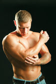 Young man having pain in his elbow — Stock Photo
