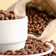 Stock Photo: Sack of coffee beans and cup
