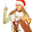 Girl with bag full of xmas gifts  — Stock Photo