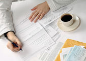 Woman working with tax documents — Stock Photo