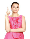 A young woman pointing at something — Stock Photo