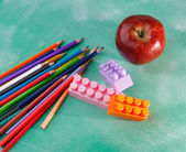 Pencils and apple — Stock Photo