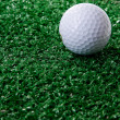 Golf ball ower green grass — Stock Photo #34781325