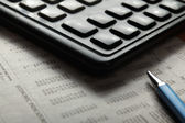 Close-up of pen and calculator — Stock Photo