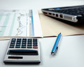 Calculator, pen, folder with documents, laptop — Stock Photo