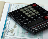 Calculator with documents — Stock Photo