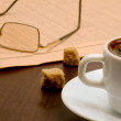 A cup of coffee, glasses and  papers — Stock Photo