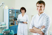 A medical doctors standing in dentist office — Stock Photo