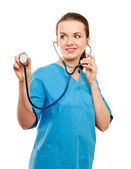 A female doctor with a stethoscope listening — Stock Photo