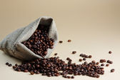 Coffee grains from a packet — Stock Photo