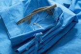 A doctors clothing with glasses — Stock Photo