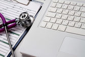 A medical stethoscope on a laptop — 图库照片