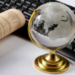 Background with laptop and globe — Stok fotoğraf