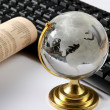 Background with laptop and globe — Stock Photo