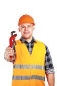 Constructor in hard helmet with pliers — Stock fotografie