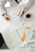 Business woman working with tax documents — Stock Photo