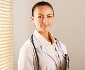 Woman doctor is standing in the office — Stock Photo