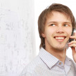 Businessman calling on mobile phone — Stock Photo