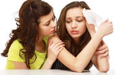 Teenage girl supporting her friend — Stock Photo