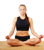 Woman in lotus position practicing yoga — Foto Stock