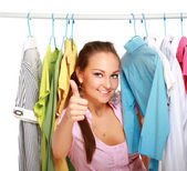 Happy girl in clothing store — Stock Photo