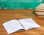 Blank notepad with pen and pencil on wooden table. — Stock Photo
