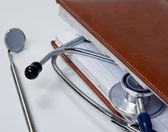 Stethoscope with reference books. — Stock Photo