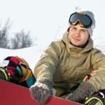 Snowboarder sitting on a ski slope. — Stock Photo #36229319