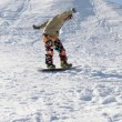 Snowboarder standing on board — Stock Photo