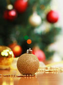 Close up decorative ball on the background of Christmas tree. — Stock Photo