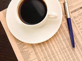 Cup of coffee near press — Stock Photo