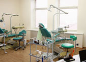 Modern Dentist's chair in a medical room. — Stock Photo