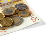 Money: euro coins and bills — Stock fotografie