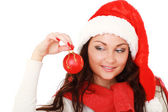 Santa girl holding a Christmas ball,isolated on white background. — Foto de Stock