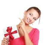 Woman holding gift box isolated on white background. — Stock Photo