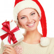 Woman in Santa hat holding gift box — Stockfoto