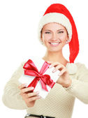 Woman in Santa hat holding gift box — Stock Photo
