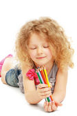 Happy little girl drawing with pencils — Stock Photo