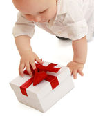 A baby with gift box — Stock Photo
