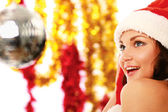 Happy girl in santa hat — Stock Photo