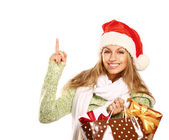 Excited girl with bag full of xmas gifts — Stock Photo